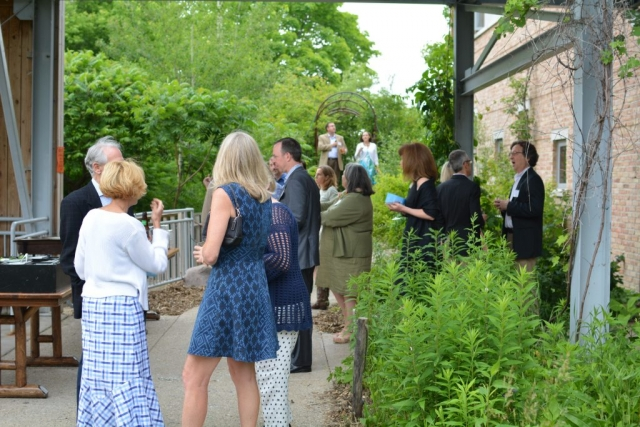 Supporters tour the grounds of the Urban Ecology Center