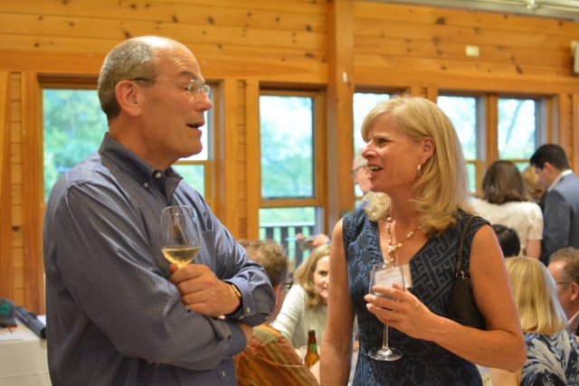 Mary Burke speaks with a fellow UEC Patron at the Summer Solstice Soiree