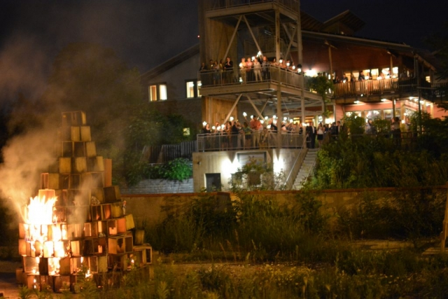 Supporters of the Urban Ecology Center light torches to celebrate the Center