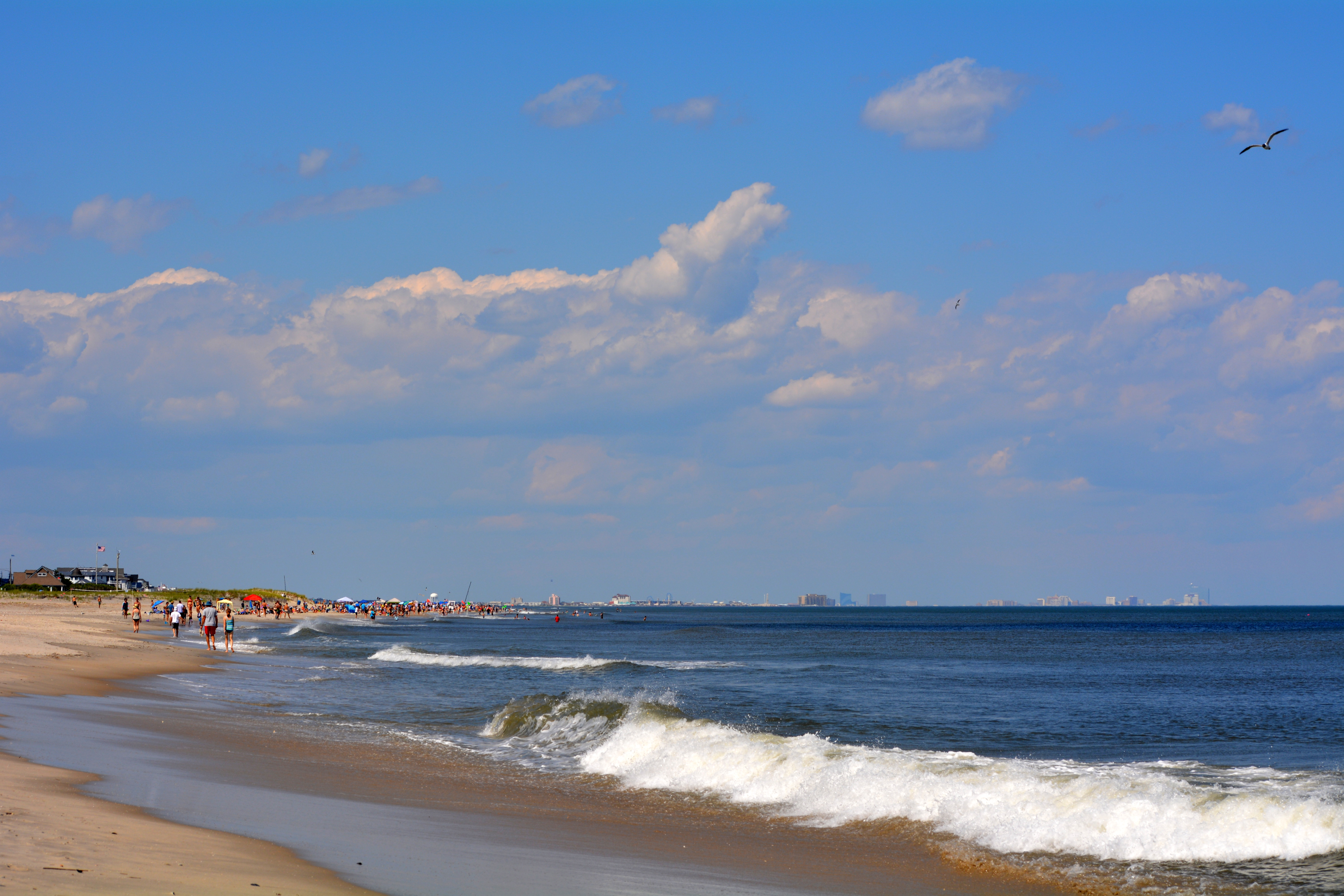 The view of a busy shore with Atlantic City in the background