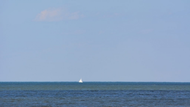 A sailboat in the distance