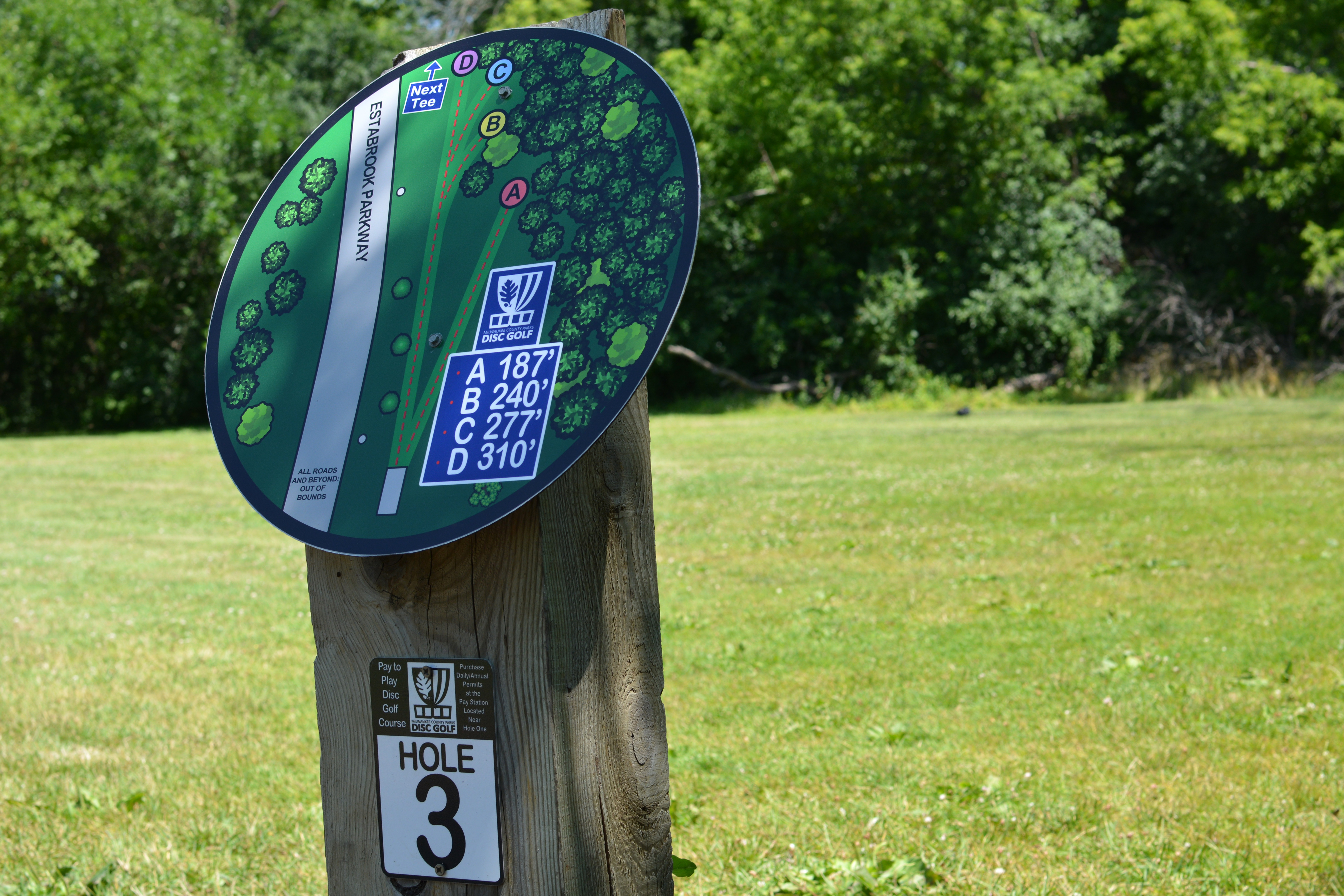 A guide to hole 3 at the Estabrook Park Disc Golf Course