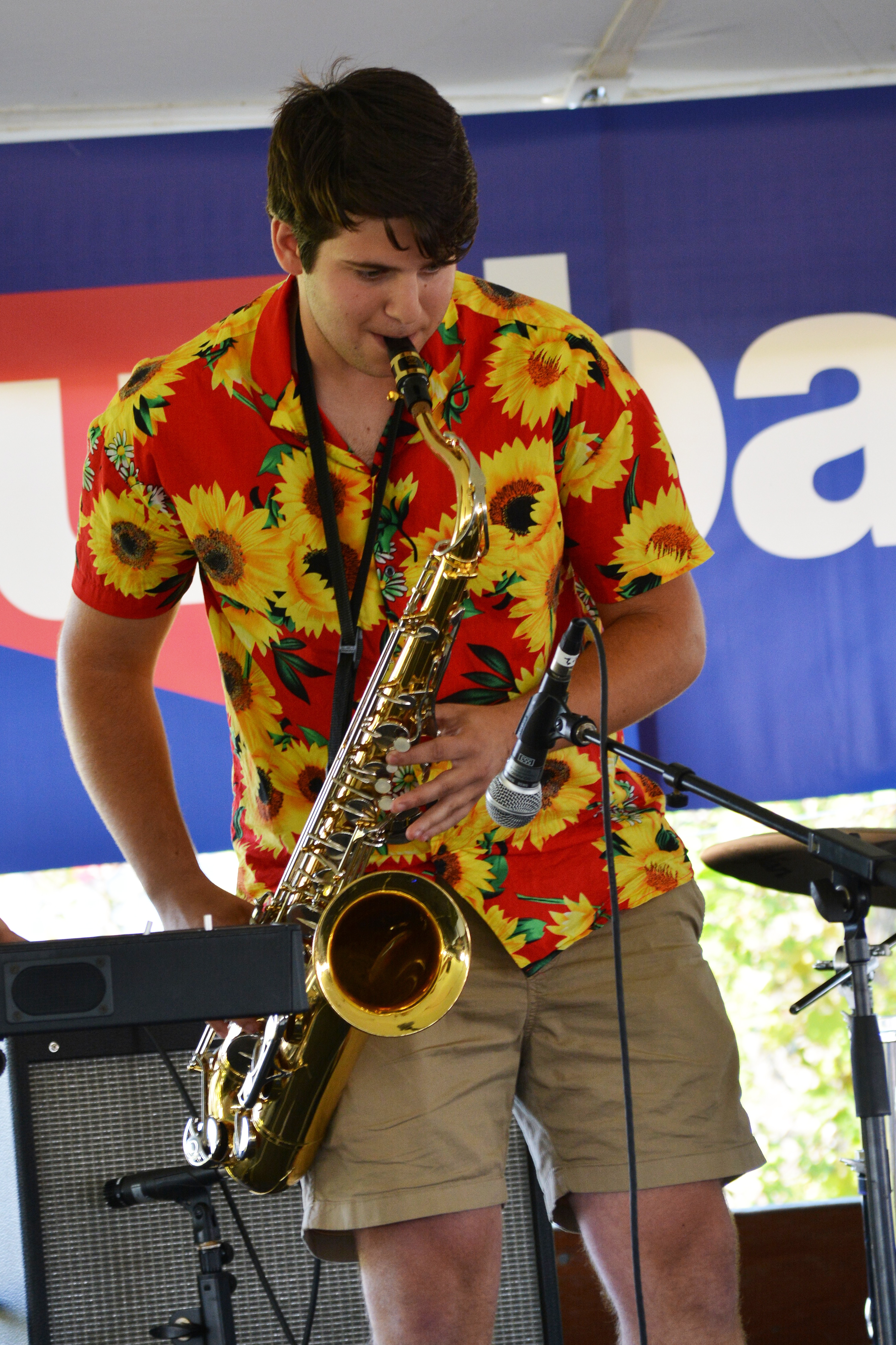 Musician plays saxophone on stage
