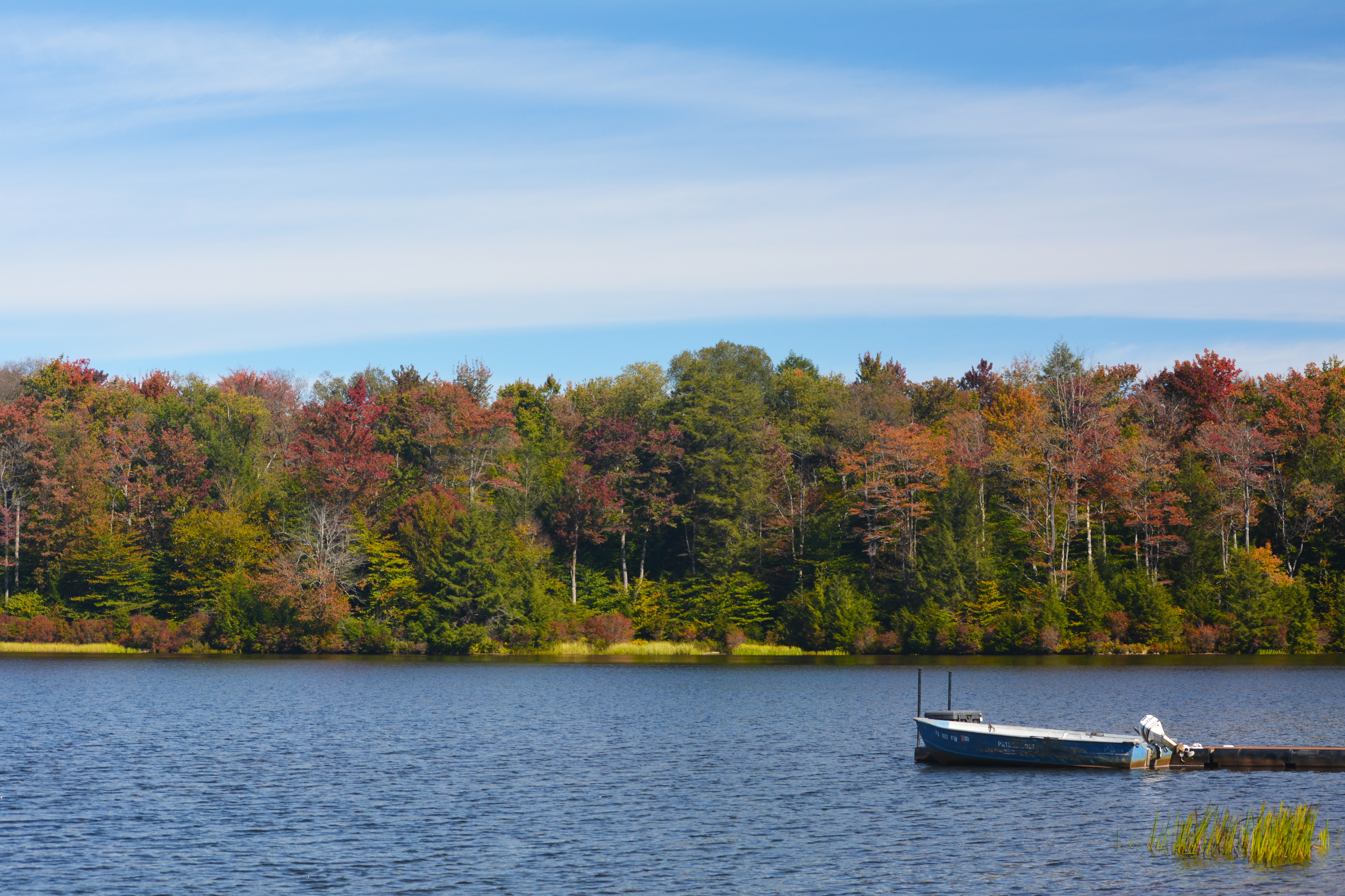 A boat sits in the lake at Ricketts Glen State Park