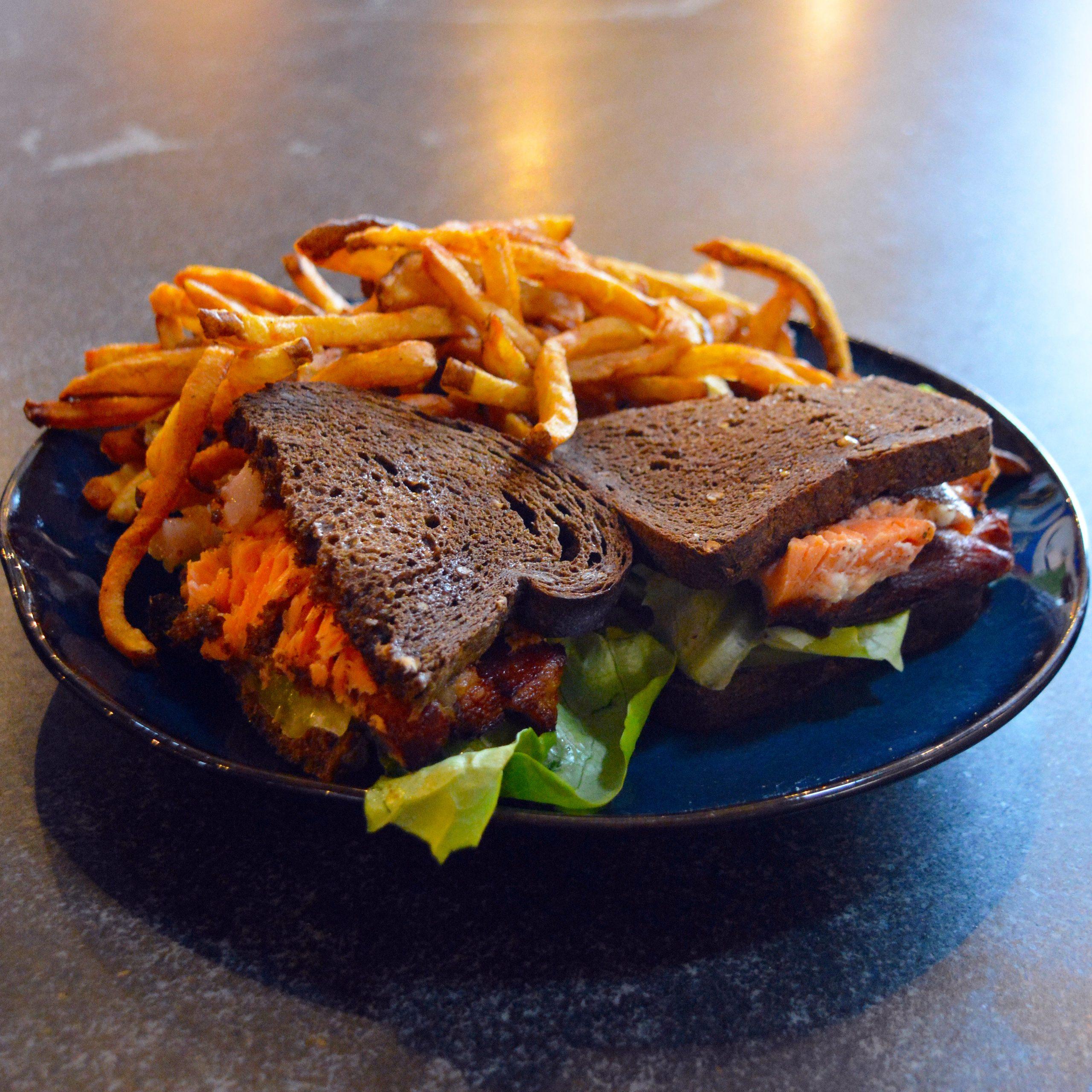 A photo of a Salmon Sandwich on Rye