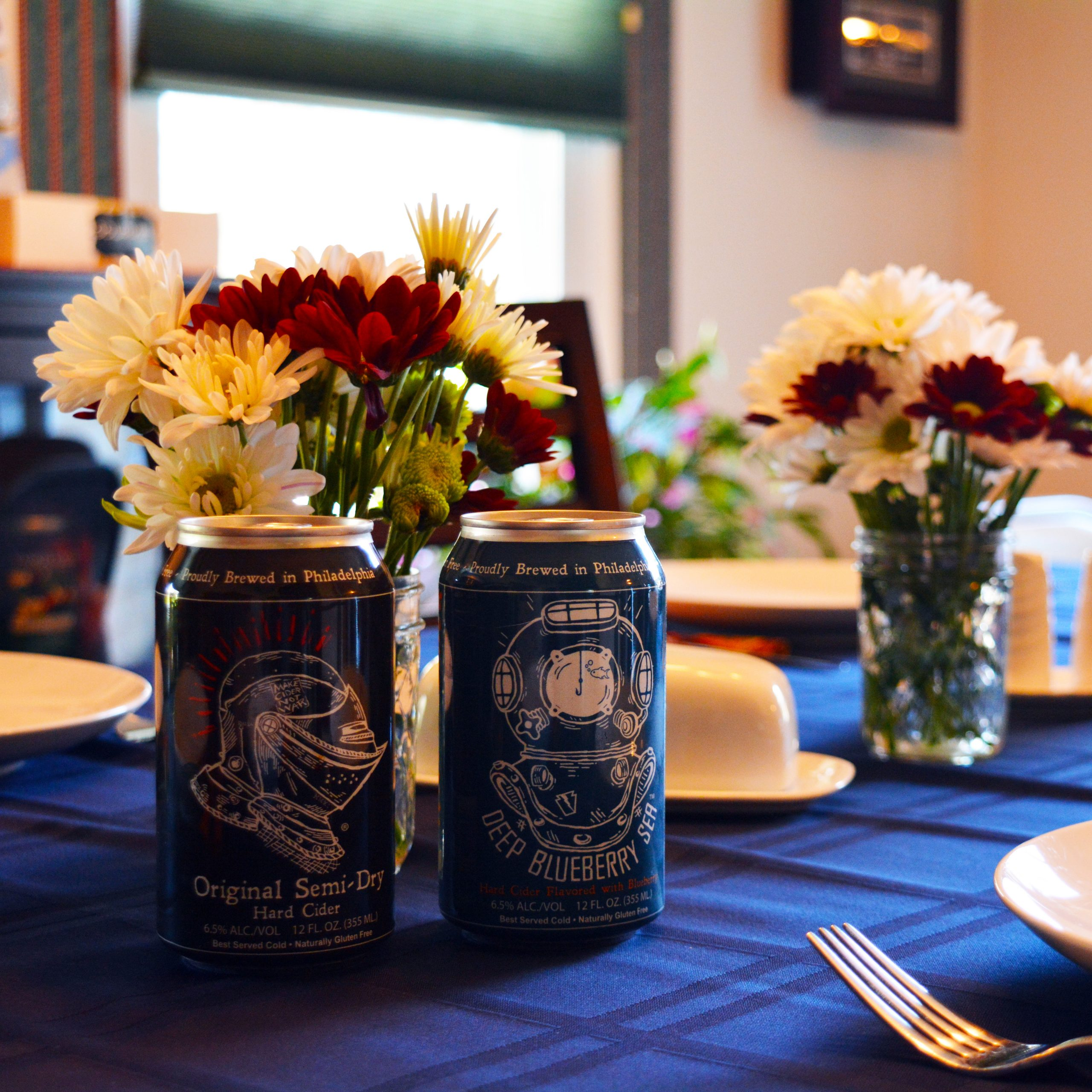 A photo of cans of Sir Charles Hard Cider on the dinner table