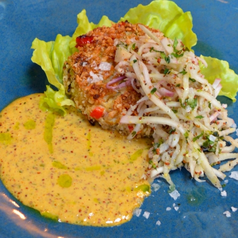 A Crab Cake with lettuce and coleslaw