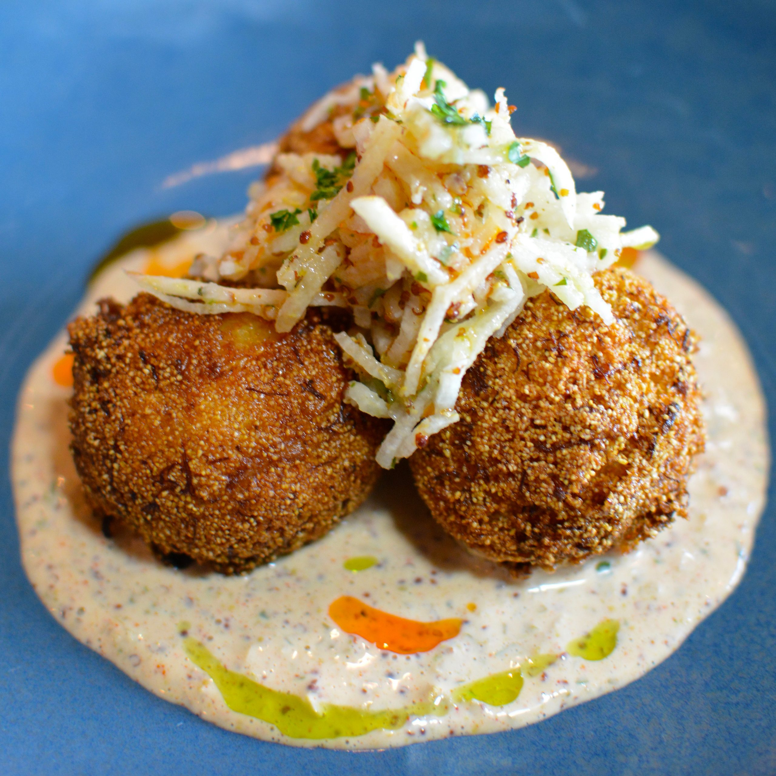 Hush Puppies topped with slaw