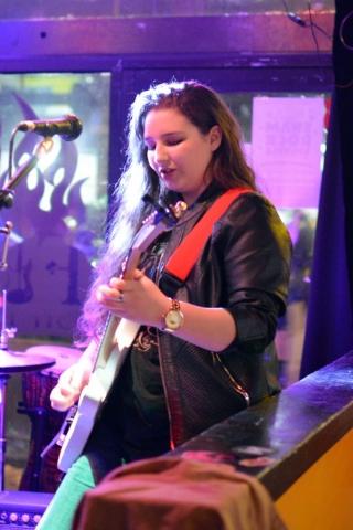 Elly Bird playing electric guitar
