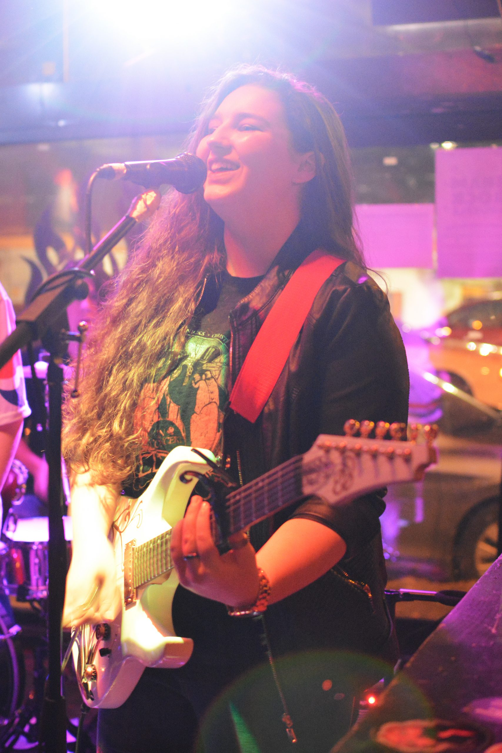 Elly Bird plays the electric guitar and sings