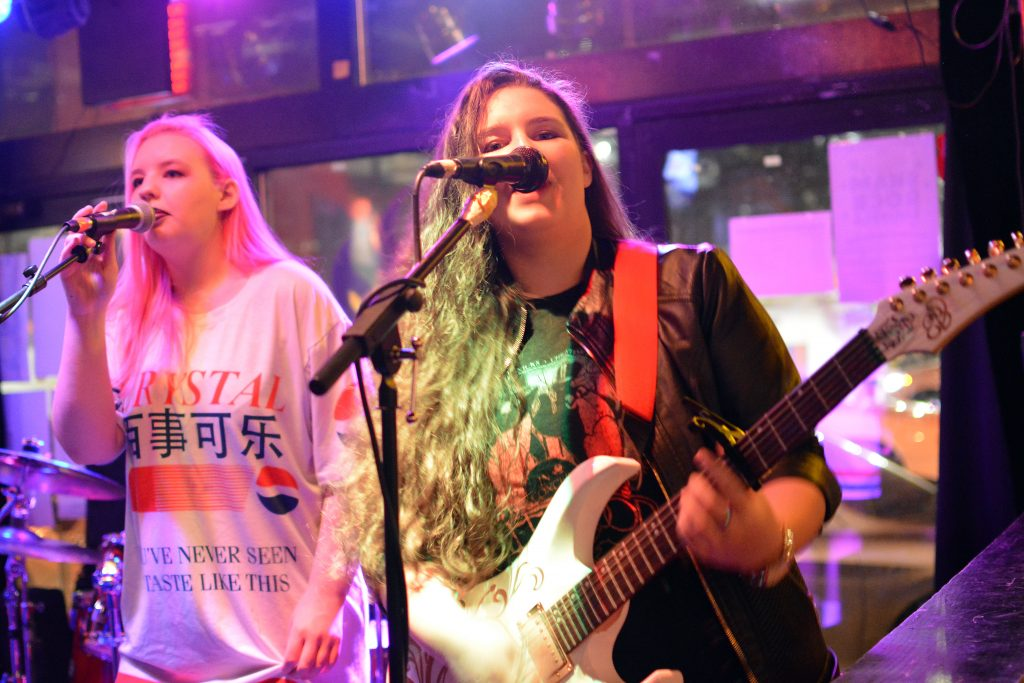 Elly and Emma Bird onstage at Fire on Water