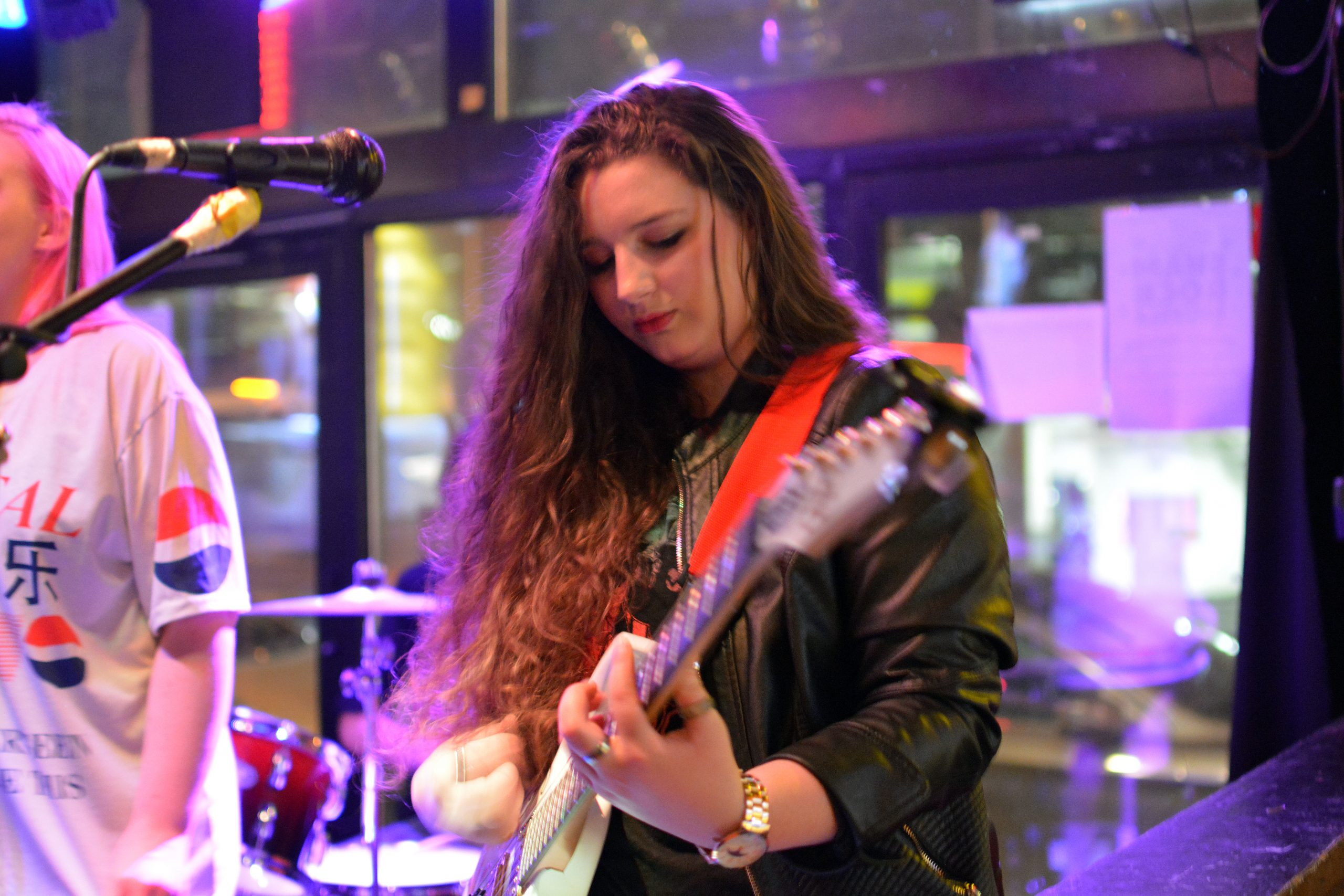 Elly Bird plays electric guitar