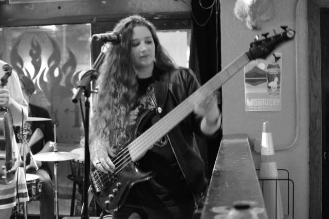 Elly Bird plays the bass guitar