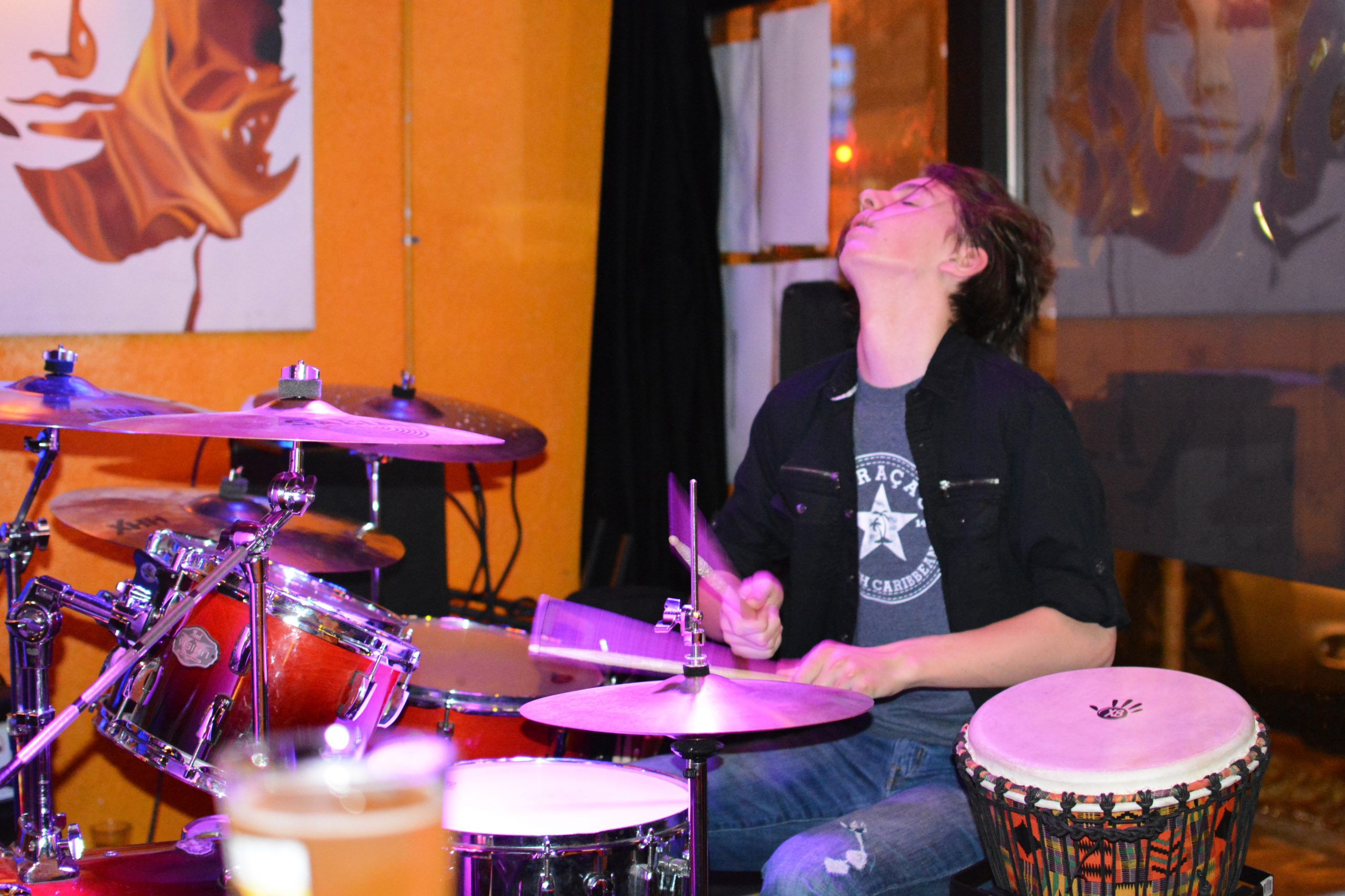 Max Bird plays the drum kit